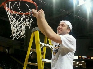 Sophomore Austin Arians helping cut down the net. Photo from @CoachLitch