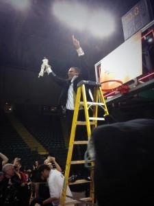 Coach Jeter celebrating by cutting down the net. Photo via @KaylaSchaffer31