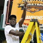 Bobo Niang celebrates with the net of the Horizon League Tournament. | Photo by Dustin Maciejewski.