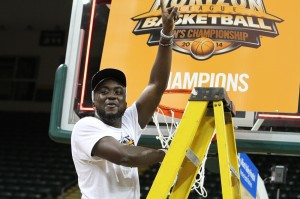Bobo Niang celebrates with the net of the Horizon League Tournament. | Photo by Dustin Maciejewski