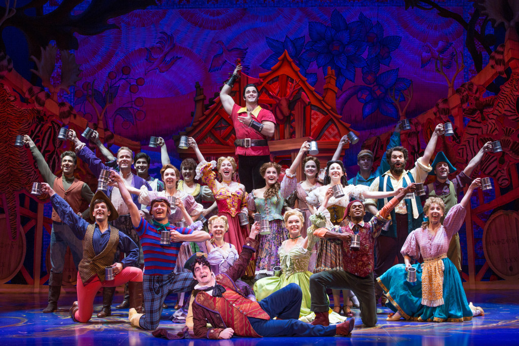 Cameron Bond as Gaston and the cast of Disney's Beauty and the Beast. Photo by Matthew Murphy.