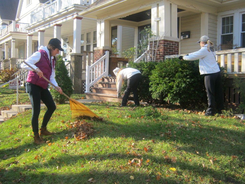 Students rake leaves in the Milwaukee community.