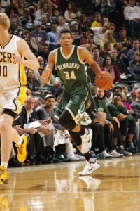 Giannis Antetokounmpo brings the ball up on a break. photo: bucks.com