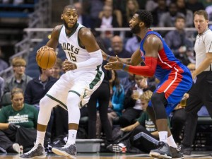 Greg Monroe will have his work cut out for him tonight against his former team and NBA leading rebounder Andre Drummond.  photo: Detroit Free Press
