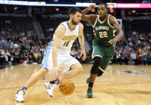 The Nuggets' Kostas Papanikolaou drives past Bucks' guard Khris Middleton during Wednesday night's game.  photo: bucks.com