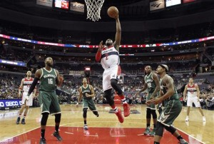 John Wall coasts through a porous Bucks defense to the hoop for two points photo: Alex Brandon, Associated Press