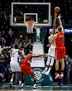 John Henson's blocked shot on Meyers Leonard sealed the victory for the Bucks. photo: NBA.com