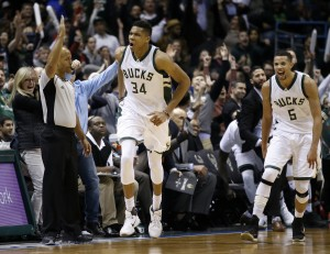 Giannis Antetokounmpo reacts after making a three-point basket during overtime (AP Photo/Morry Gash)