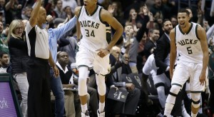 Giannis Antetokounmpo's outburst of 28 points and 16 rebounds was one of the helping hands in Milwaukee's overtime victory against Atlanta.  photo: Morry Gash, AP