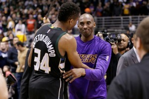 Giannis Antetokoumpo and Kobe Bryant share a moment after Bryant's final game in Milwaukee. (Image from news8000.com)