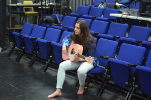 Director Solana Ramírez-García strums her guitar along with the actor's singing.