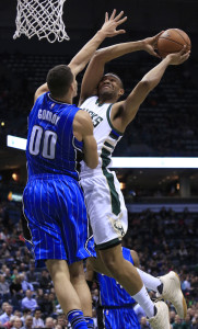 Milwaukee Bucks forward Jabari Parker, right, goes up for a basket against Orlando Magic forward Aaron Gordon, left, during the second half of an NBA basketball game Friday, April 1, 2016, in Milwaukee. (AP Photo/Darren Hauck)