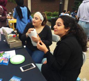 Zainab Fleifel and Layah Elqaq enjoying some food.