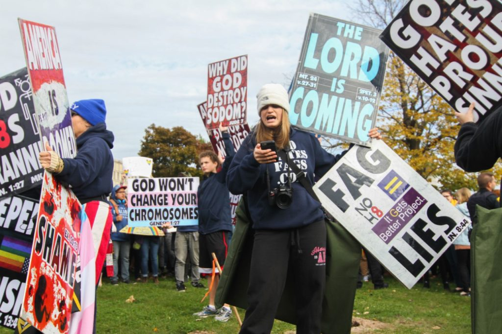 "The WBC held signs saying ""God Hates Trannies"" and ""God won't change your chromosomes."""